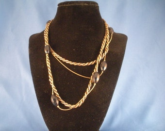 Long two stranded black and gold twist chain and black beaded necklace. (N31)
