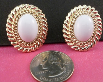 Reduced Pierced gold and white oval pierced earrings. (P89)