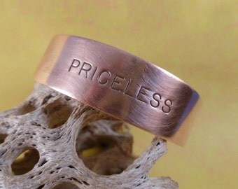 Copper Bracelet inscripted with the word Priceless. (B27)