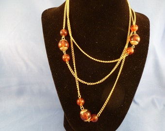 Reddish Amber beaded gold necklace. (N72)