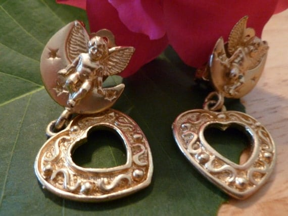 Gold Cupid and Dangling Heart Clip Earrings. (C109)