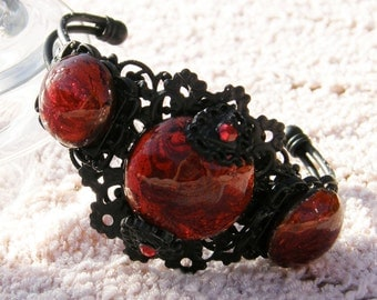 Stunning Black Filigree Bracelet Covered in Beautiful Red Glass Cabochon's