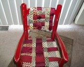 Childs rocker with necktie seat
