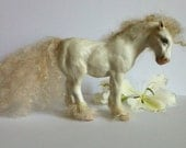 A white horse sculpture, ooak hand made in polymer clay.