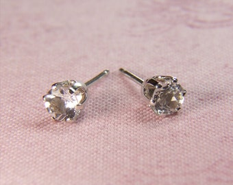Sparkling White Topaz, 4mm Round Cut, Sterling Silver Stud Earrings