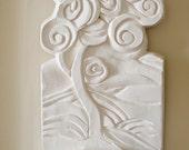 white sculptural tea light holder