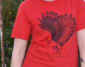 Flying Pig Design in Black Ink Printed on a Red Jerzees Brand T Shirt