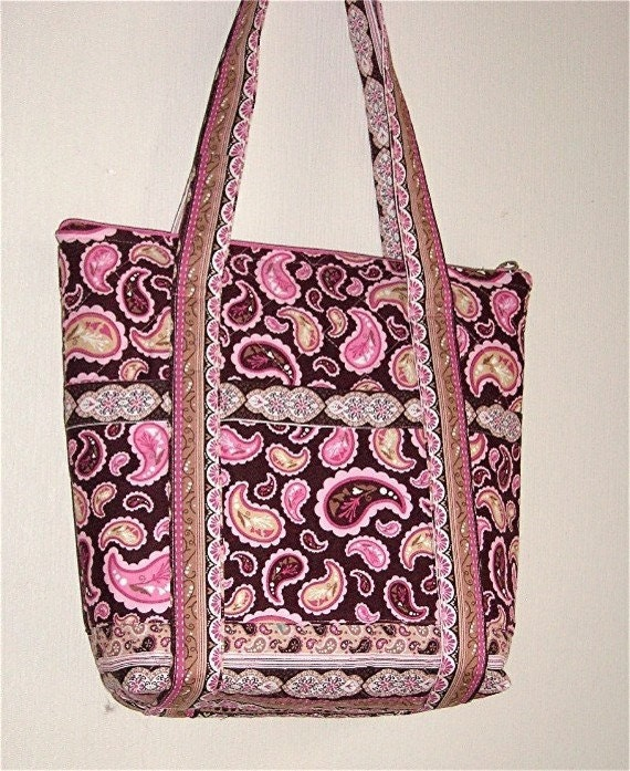 Medium size quilted purse with pink and rose colored paisley printed fabric.