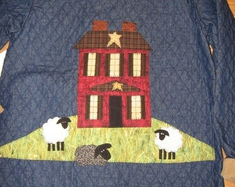 Quilted jacket with willow tree, saltbox house, and playful sheep