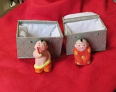 Pair of Chinese children figures/ dolls painted clay
