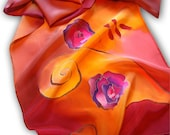 Hand painted silk scarf with floral theme. Orange, red, purple.