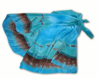 Hand painted silk scarf with flowers in intense shades of blue. Blue, gray, silver.