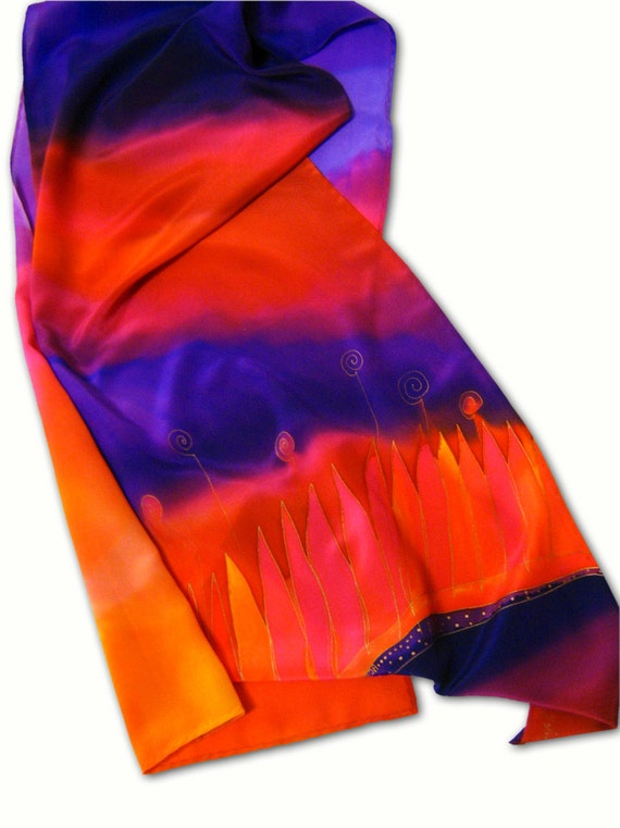 Hand painted silk scarf with the motif of blazing grass. Red, purple, orange.