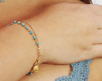 Gurlcha: Turquoise and gold bracelet. Gold filled satellite chain, with a vermeil lotus charm.  Spirit.
