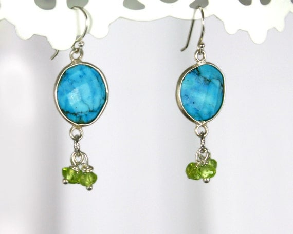 Jubita. turquoise peridot and silver earrings. Exotic earrings with sterling silver bezel framed stone green rondelles