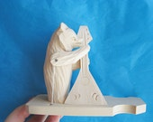 "Hand Carved Moving Wooden Toy ""Bear playing balalaika"""