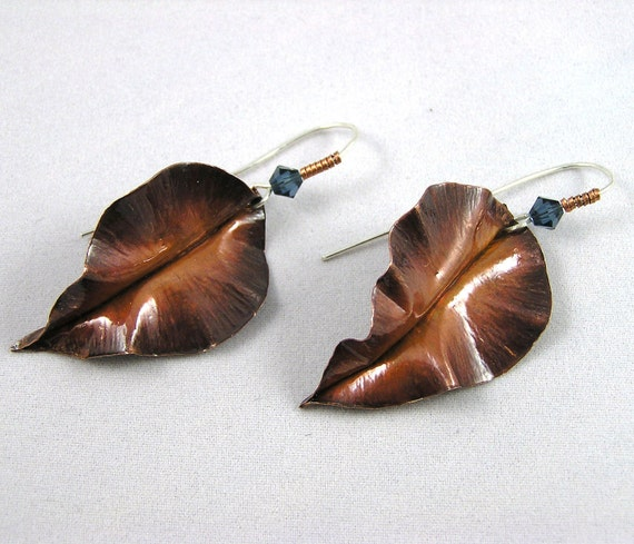 Fold formed copper and sterling silver leaf earrings with teal Swarovski crystals