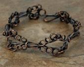 Oxidized copper looped bracelet