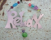 Relax ornament in brushed silver metal with decorative beaded hanger