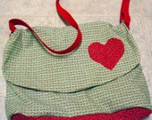 Green messenger bag with heart