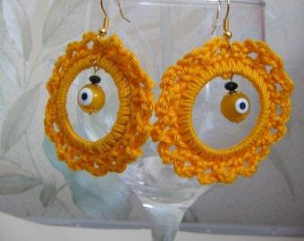 Yellow crochet earrings.