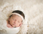 Darling newborn velvet criss cross headband in soft pink and creme or gold hues pefect photography prop