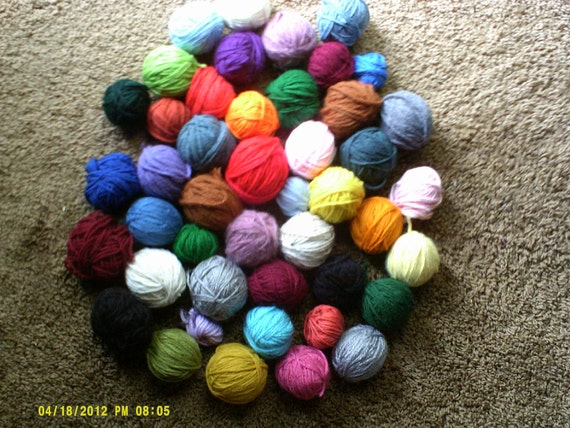 11cents a ball... a lot of 50 granny square balls of yarn..very few alike ...good condition ..many colors