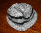 Hand knit baby hat.
