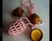 An acorn necklace, a cozy, to keep your acorn safe.