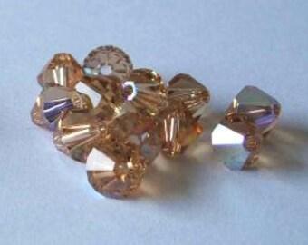 144 SWAROVSKI 5301 Bicone Crystal Beads 4mm Light Colorado Topaz AB