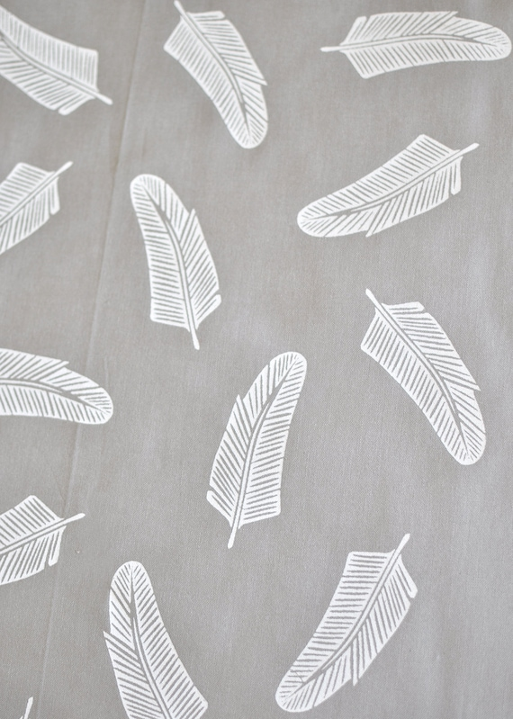 quill in alabaster on grey cotton handprinted fabric panel