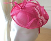 Pink Disc Fascinator Sinamay and Feather on a hairband, Ideal for weddings and races.