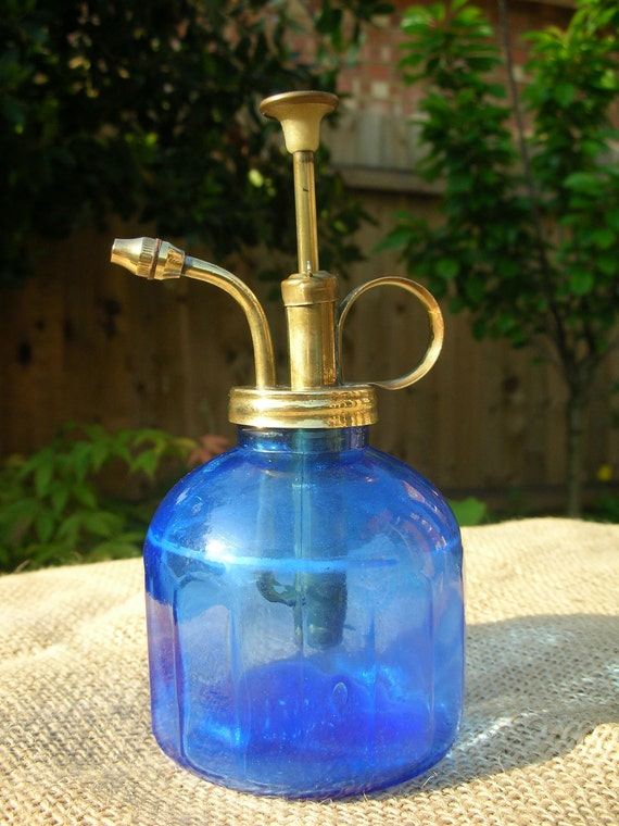 Gorgeous plant mister in blue glass and brass