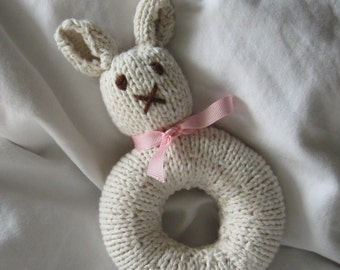 Baby's First Knitted Natural Bunny Baby Rattle (shown with pink and pink gingham ribbon)