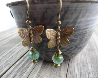 Antique Bronze Butterfly Earrings with green czech glass beads