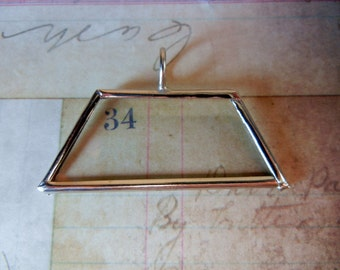Nickle finish quadrilateral glass pendant