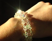 Pink and clear AB swarovski crystal beadwoven bracelet with a silver tone magnetic clasp