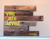 You are loved.  Hand painted sign on reclaimed wood.