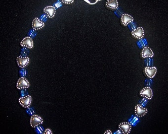Delicate Beaded Bracelet with Ornate Silvertone Hearts and Square Blue 4 mm Seed Beads