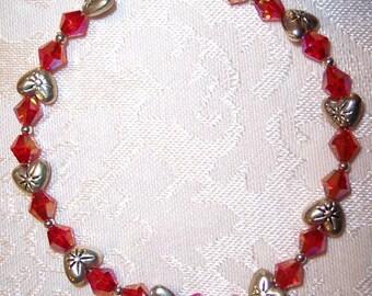 8 1/4 Inch Silver Hearts and Reddish Orange Czech Crystal Beaded Bracelet