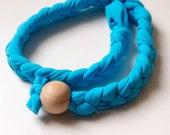 Blue HEADBAND of braided elastan yarn and wood bead as a lock, summer look