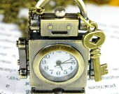 robot pocket watch necklace ,with its little key