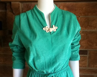 Vintage 1960s polyester green mini dress