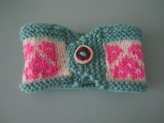 Seafoam green and pink heart motif hand knit coffee cup cosy