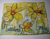 Free motion embroidery, black line drawing on daffodil colours, I wander lonely