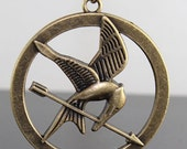 HOT STYLE---The Hunger Games standard pendant ,Inspired Mockingjay Necklace-double side