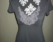 Charcoal grey top with applique trim
