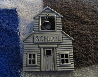 Pewter looking school house pin