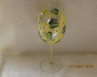 Wine glasse with yellow flowers green leaves hand painted