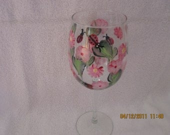 Wine glasses with ladybugs in pink flowers hand painted